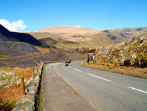 The Llanberis Pass. Two motorcycles on the Llanberis Pass, Snowdonia, North Wales Royalty Free Stock Images