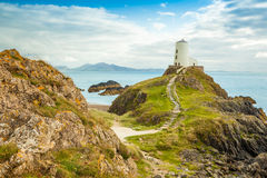 Llanddwyn Island - Anglesey. Lightouse on a hill overlooking the Menai Straits, Llanddwyn Island, Anglesey, North Wales Stock Photo