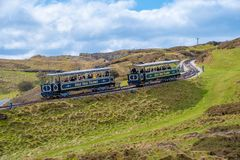 Great Orme Tramway. LLANDUDNO, WALES - APRIL 14th, 2018: The Great Orme Tramway trams about to pass each other. It is the only surviving cable operated street Royalty Free Stock Image