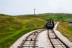 LLandudno, Wales, North Shore Beach, UK - MAY 27, 2018 Old tramway getting on devided railway Tram choosing it s right way to rea. Old blue vintage tramway Stock Image