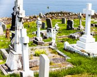 LLandudno, Wales, North Shore Beach, UK - MAY 27, 2018 Tombstones in cemetery at sunny Some headstones old abandoned churchyard. G royalty free stock photos