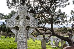 Llandudno , Wales, UK - April 22 2018 : Dramatic graves standing at St Tudno`s church and cemetery on the Great Orme at Royalty Free Stock Photo
