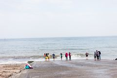LLandudno, Wales, UK - MAY 27, 2018 Crowd of people standing on the seashore. Vacation with friends on the sea. Party on the sea b royalty free stock photos