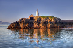 Llandwyn Island Lighthouse and boathouse Stock Image