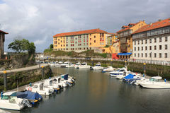 Llanes with boats in the port and some buildings Royalty Free Stock Image