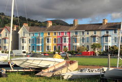 Llanfairfechan, north Wales. An image of Llanfairfechan, north Wales with their brightly coloured houses, complete with gloomy sky Royalty Free Stock Photography