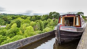 Llangollen Aqueduct in Wales, UK. A boat passing the Pontcysyllte Aqueduct the highest in the world near Llangollen in Wales, UK stock photos