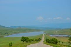 Llano con las colinas Fotografía de archivo libre de regalías