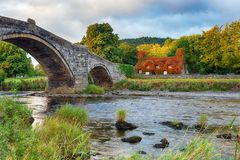 Llanrwst Bridge in North Wales. Autumn at Pont Fawr bridge over the river Conwy at Llanrwst on the edge of Snpwdonia National Park in north Wales royalty free stock photos