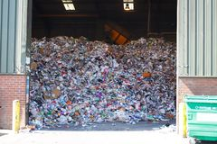 Llarge pile of colored paper waste at the waste recycling plant. Large pile of colored paper waste at the waste recycling plant for further sorting and recycling royalty free stock photography