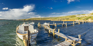 Llaut on wooden dock Stock Photography