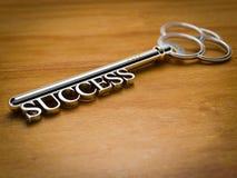 Llave al éxito - madera Imagen de archivo libre de regalías