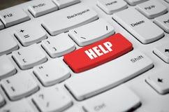 Llave de ayuda roja en el teclado blanco Fotos de archivo libres de regalías