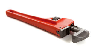 Llave de tubo anaranjada en blanco Fotos de archivo libres de regalías