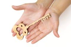 Llave del amor en el fondo blanco Imagen de archivo libre de regalías