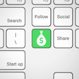 Llave del dinero en el teclado Fotografía de archivo libre de regalías