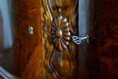Llave en una puerta del armario Fotografía de archivo libre de regalías