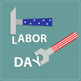 Llave feliz y martillo de la llave del Día del Trabajo con diseño plano del stip de la estrella Imagen de archivo