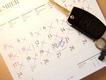 Llave y calendario del coche imagen de archivo libre de regalías