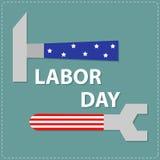Llave y martillo de la llave del Día del Trabajo con diseño plano del stip de la estrella Foto de archivo libre de regalías
