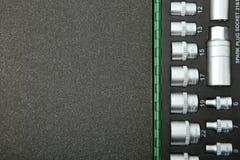 Llaves de zócalo en un caso fotos de archivo