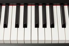 Llaves del ébano y de la marfil del piano de cola Imagen de archivo libre de regalías