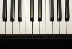 Llaves simples y limpias del piano, una octava, fondo de la música imagenes de archivo