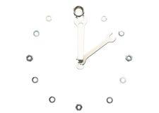 Llaves, tuercas, aislado, hechas en una forma de un reloj Imagenes de archivo