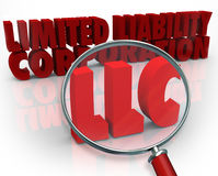LLC Magnifying Glass Limited Liability Corporation Red Words. Magnifying glass on the acronym LLC standing for Limited Liability Corporation to illustrate the Stock Photography