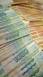 Lle banconote russe di mille e cinque mila rubli Migliaia nella priorità alta Immagini Stock