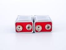 Lle batterie da 9 volt, fondo Fotografia Stock