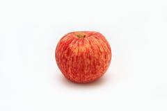 Lle mele di un rosso con il fondo bianco dell'isolato Fotografie Stock