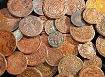 Lle monete bronzee antiche XIX del secolo Fotografia Stock