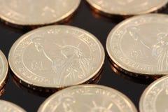 Lle monete di un oro del dollaro Fotografia Stock