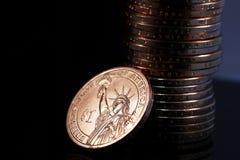 Lle monete di un oro del dollaro Fotografia Stock Libera da Diritti