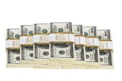 Lle pile di 100 banconote in dollari isolate su bianco Immagine Stock Libera da Diritti