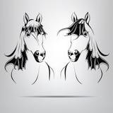 Lle siluette di due cavalli. illustrazione di vettore Fotografie Stock Libere da Diritti