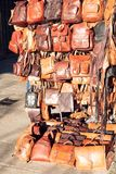 Lleather goods for sale at an outdoor. Street market. royalty free stock photography