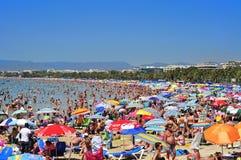 Llevant Beach, in Salou, Spain. SALOU, SPAIN - AUGUST 10: Vacationers in Llevant Beach on August 10, 2012 in Salou, Spain. Salou is a major destination for sun Royalty Free Stock Photo