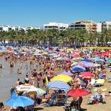 Llevant Beach, in Salou, Spain. SALOU, SPAIN - AUGUST 10: Vacationers in Llevant Beach on August 10, 2012 in Salou, Spain. Salou is a major destination for sun Royalty Free Stock Images