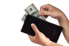 Llevar a cabo 100 billetes de dólar Imágenes de archivo libres de regalías