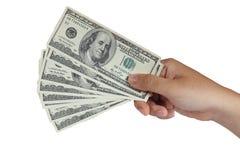 Llevar a cabo 100 billetes de dólar Fotografía de archivo