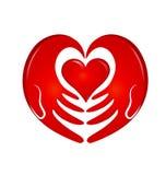 Llevar a cabo el logotipo del corazón de las manos Fotos de archivo