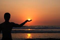 Llevar a cabo el Sun Fotos de archivo libres de regalías
