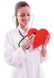 llevar una capa blanca con un corazón Imagen de archivo libre de regalías