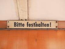 Lleve a cabo por favor la muestra en la tranvía alemana foto de archivo