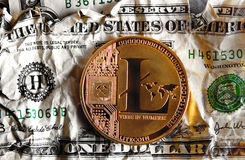 Llitecoin on Crushed dollar banknote. Litecoin on Crushed dollar banknote.Concept of  Monetary system collapse Royalty Free Stock Images