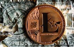 Llitecoin on Crushed pyramid dollar banknote. Litecoin on Crushed  dollar banknote.Concept of  conspiracy Stock Images
