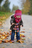 Llittle baby in an autumn park Royalty Free Stock Images