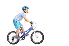 Llittle boy with blue helmet riding a small blue bike isolated o Stock Images